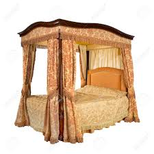 old vintage four poster bed with drapes and curtains isolated