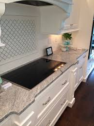 Kitchen Countertops And Backsplash by Vintage White Silver Cloud Granite Counter With Whtie Cabinets