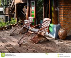 Patio Recliner Chair by Wood Reclining Chairs On Patio Stock Image Image 28909789