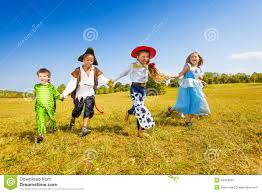 large group of kids in halloween costumes run stock photo image