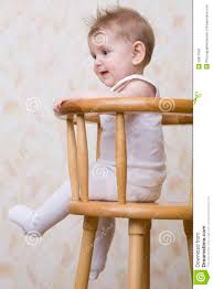 High Sitting Chair Playful Baby Boy Sitting On High Chair Royalty Free Stock Photo