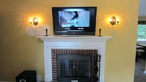 outstanding hidden tv mount over fireplace with wires photos