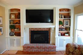 before u0026 after mantel covering the tv niche above the fireplace