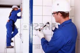 electricians wiring a white and blue building stock photo picture