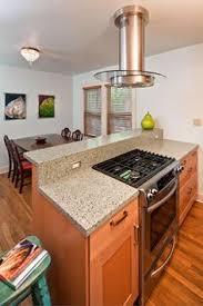 kitchen island with range island with storage slide in range and breakfast bar seating