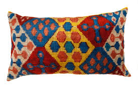allover geometric patterned ikat pillow with yellow backing
