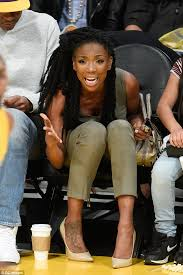brandy the game hair cut brandy is chic in khaki jumpsuit and nude stilettos at basketball