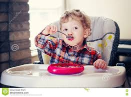 High Sitting Chair Portrait Of Cute Adorable Caucasian Child Kid Boy Standing In High