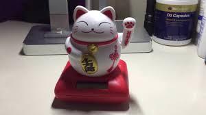 solar powered maneki neko welcoming lucky beckoning fortune cat