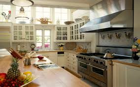 traditional wooden kitchen design with wooden cabinets and a