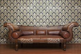 old fashioned leather sofa and wallpaper pattern stock photo