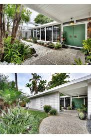 midcentury mid century modern white home exterior high tall front