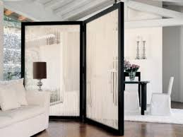 curved black frame room divider ideas with white tulle curtain