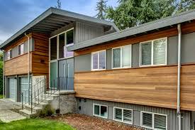 split level home exterior refresh of 1970 s split level home modern split