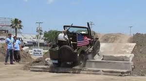 old military jeep old military jeep conquers difficult obstacle at jeep beach 2014