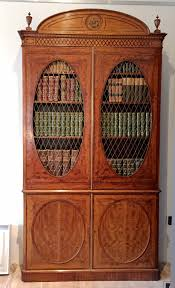 fine hepplewhite decorated inlaid satinwood and mahogany two part