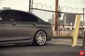 black bmw 5 series on vossen wheels