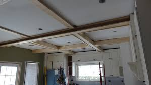 ceiling wood coffered ceiling with lights and chandelier matced