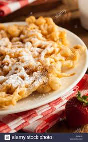 homemade funnel cake with powdered sugar at the fair stock photo