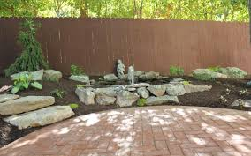 beautiful rumbled red clay paver patio before and after by johnson
