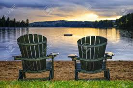 Chairs On A Beach Two Wooden Chairs On Beach Of Relaxing Lake At Sunset Algonquin