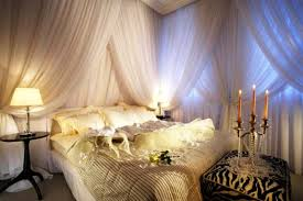 other romantic bedroom flowers candles white courtains warm light