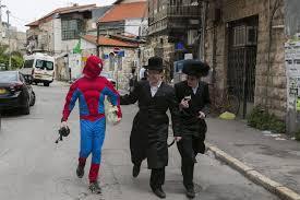 why do jews dress up for purim jewish world features haaretz