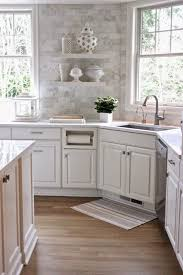 Cottage Kitchen Backsplash White Quartz Countertops And The Backsplash Is Marble