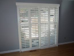Patio Doors Exterior by White Stained Wooden Frame 4 Glass Sliding Patio Door Panel Placed