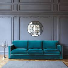 Living Room With Blue Sofa by Classic Elegant Living Space Design Fancy Blue Sofas Round Mirror