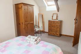 frankaborough farm dartmoor farm accomodation on the first floor there s a bathroom with shower over bath toilet and washbasin together with 2 bedrooms one double one twin