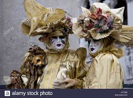carnevale costumes two golden costumes and masks carnevale di venezia carneval in
