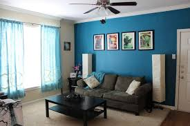 blue living room paint ideas with dark grey sofa and black coffee
