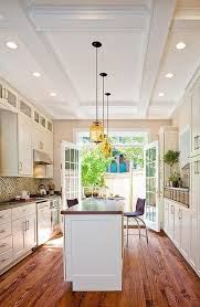 galley kitchen design with a island the wood grain