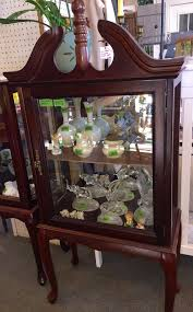 how to clean cherry wood cabinets 8425 h curio cabinet ornate top cherry wood cornice top curio with single glass door and glass sides