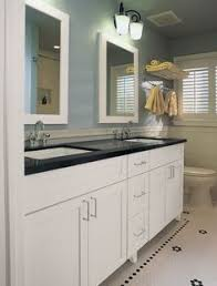 white bathroom vanity cabinet the master bathroom has black granite countertops with double vanity