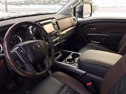 nissan cummins interior review 2016 nissan titan xd fills the empty space in the middle