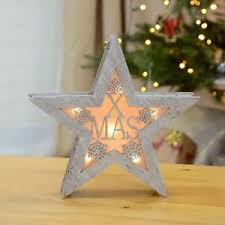 light up xmas pictures silver laser cut wooden star light up christmas decoration xmas led