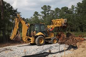 new four wheel drive backhoe from caterpillar complements its
