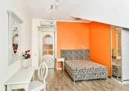 modern art deco style bedroom in bright orange colors with zebra
