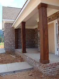 Ranch House With Wrap Around Porch Wooden Porch Posts And Columns The Rickety Brick House