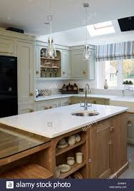 traditional kitchen with modern tap and sink in breakfast bar