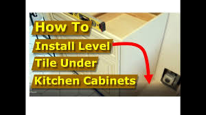 install base cabinets before flooring how to install level tile flooring kitchen cabinets stove dishwasher