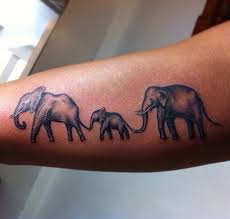this of an elephant family tattoos
