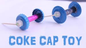 make rubber band powered bottle cap toy with tooth pic kids
