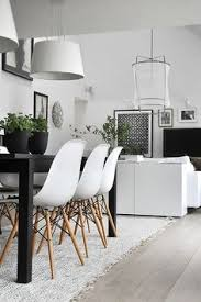 black table white chairs scholten baijings for karimoku new standard architecture design