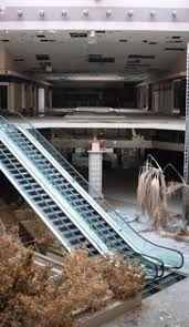 this abandoned shopping mall looks straight out of dawn of the