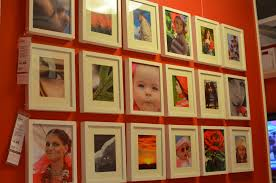 shopping ikea and ballard designs the portraits fill the frame of course the white frames and matting really pop off the red wall a lot of the photos have touches of red in them as well