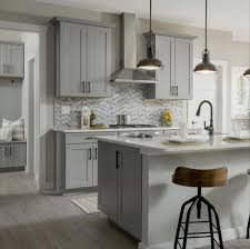 what color kitchen cabinets go with agreeable gray walls sherwin williams agreeable gray cabinets end of island
