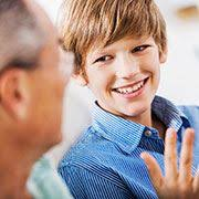 Teenaged boy and dad problem solving and talking credit iStockphotos com skynesher